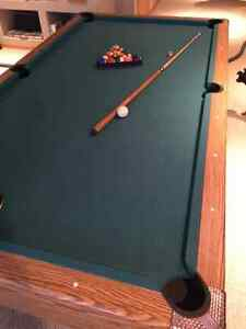 Pool table with minor tear.