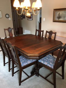 Antique hard wood dining table and chairs