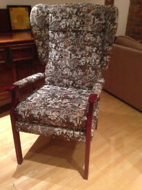 Orthopaedic high back winged armchair in very good condition