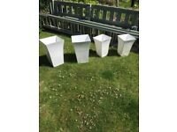 4 large plastic garden pots. £15 for all 4