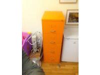 an orange filing cabinet
