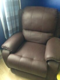 Two seater brown recliner suite and matching armchair