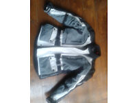 IXS motorcycle jacket. Size Medium. Air vents front and back. Thermal under jacket.