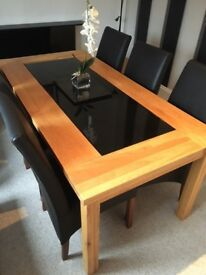 Oak and Black glass dining table and 6 Genuine leather black dining chairs