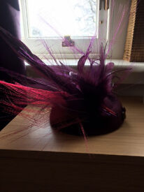Beautiful plum formal/wedding hat with feathers, only worn once so in excellent condition