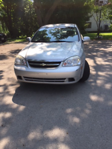 2004 Chevrolet Optra - Engine great, drives, good for parts