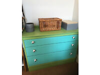 Wooden chest of drawers - blue/green with ornate white knobs. Quirky!