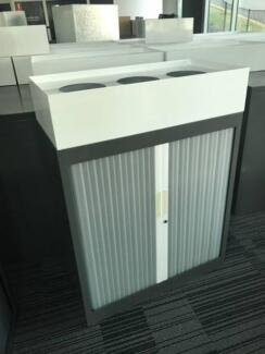 Tambour door stationary cabinet with planter box