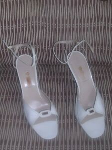 Designer womens shoes / heels in excellent condition