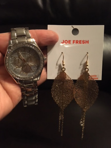 silver tone watch and gold tone earrings