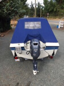 BRAND NEW 60 HP YAMAHA outboard (34hrs) with boat & trailer