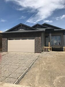 FULLY DEVELOPED WALK OUT BUNGALOW IN RIVERSTONE