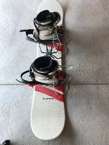 One time used snowboard, boots, helmet and goggles