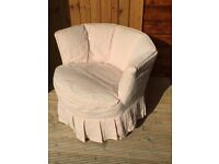 Funny little pink upholstered circular nursing chair