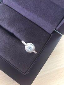 18ct Rose gold, diamond halo cluster ring, 0.51ct round brilliant cut diamond.
