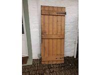 Pine internal door. 80 x 193 cms. Now quite weathered. Free.
