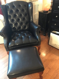 Tufted black wing chair and ottoman