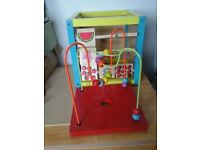 Solid wood activity cube with 5 different activities, excellent condition. Fun and educational.