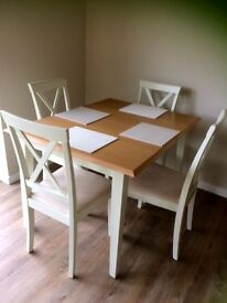 Extending Dining table and 4 chairs for sale