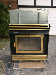 Napoleon wood stove with 4 sections of pipe.