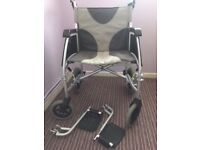 Enigma lightweight fully folding wheelchair with wider seat. Nearly new condition, hardly used