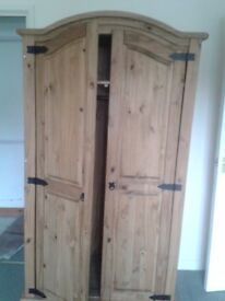 Double pine wardrobe with black metal door handles and hinges