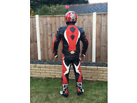 Red and White Matching 2 Piece Leathers, Boots, Helmet, and Gloves in very good condition