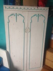 Matching wardrobe and chest of drawers: hand painted.