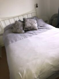 Double bed with mattress- practically brand new as only used handful of times