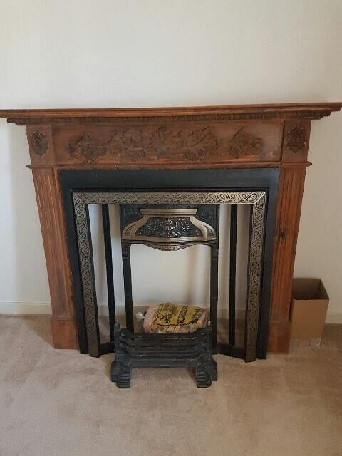 Cast Iron & Wooden Fireplace with accompanying art nouveau style tiles