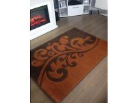 Orange and Brown Rug in good condition