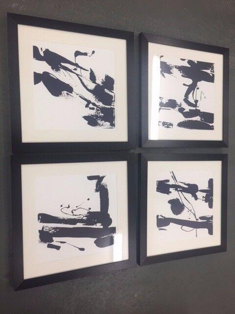 A set of 4 Black and white ink splash effect framed prints