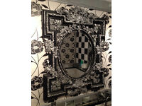 Two large black and silver framed mirrors