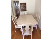 `White dining table and 8 chairs