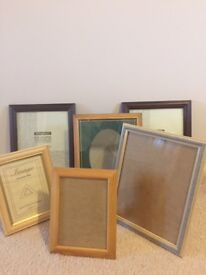 A selection of 16 photo frames in different finishes and various sizes