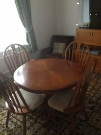 42 inch diameter table with four chairs.