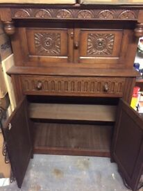 Vintage oak cabinet with elegant detail, shelving, drawer and two cupboards