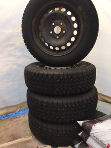 Four Goodyear Nordic Studded Snow Tires