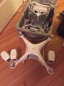 DJI Phantom 4 w/two extra batteries like new condition