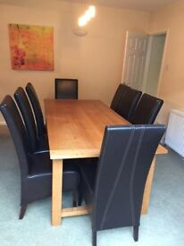 Oak Dining Table & Chairs in excellent condition. Table - 220cm x 100cm & eight chairs