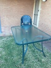 Green outdoor table with matching plastic chairs Lakelands Lake Macquarie Area Preview