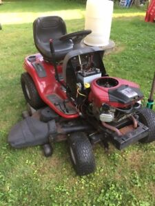 riding lawn mower for sale $400.00 runs well, but not under load