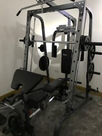 Smith Machine and 125kg of weights