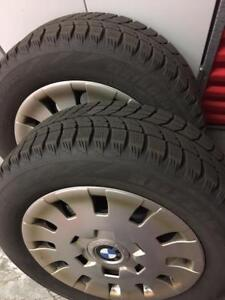 "Four  15"" Winter Steel Rims size: 205/60R15 with 2 Tires"