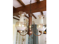 Substantial vintage glass and wood ceiling light. Full working order.