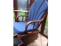 Beautiful oak glider rocking chair with blue cushions