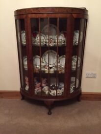 Pretty bow fronted walnut veneer display cabinet, good condition with 2 glass shelves and key.