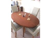 Teak dining table and 4 mutliyork chairs
