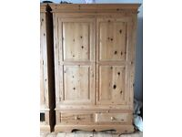 Pair of antique pine wardrobes