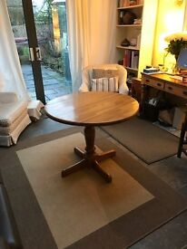 Lovely warm honey-coloured wooden dining table